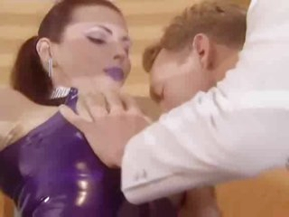 Latex maid in braided pigtails takes knob
