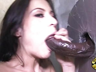 Tattooed black haired pornstar sucks black glory hole shlong