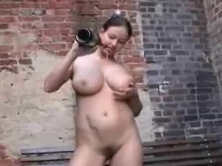 Curvy girl fucks champagne bottle outdoors