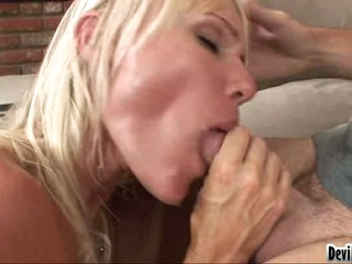 Daring blondie is pleasant her lover's stiff cock in her awesome mouth
