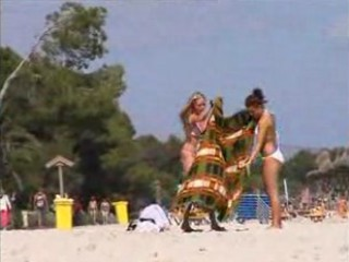 2 topless lesbian girls on the beach