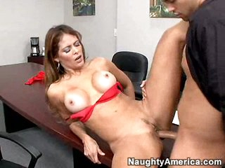 Tired of answering phones, hot secretary Monique Fuentes answers to a large cock