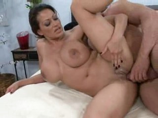 Whilst playing with her massive tits, Ava Lauren takes a coarse ramming