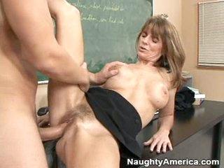 A hard cock gets slammed into mature slut Trisha Lynne's curly pussy.