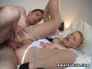 Amateur Milf sucks and fucks a young guy with facial cumshot