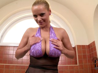 Sheila Grant wears lace violet bra and see through black nylon panties. She poses in the bathroom. Her big breasts are amazing. Sheila Grant will take your breath away.