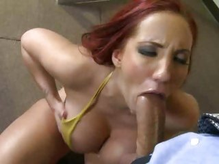 Saucy Kelly Divine throat fucks a stiff boner