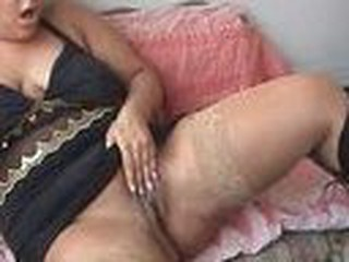 Plump girl with massive breasts gets off with a dildo