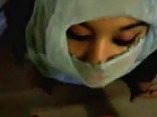 Submissive Arab woman gets facial.