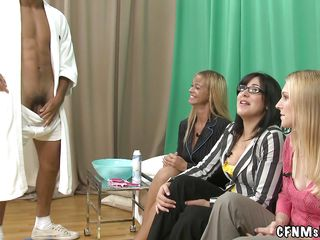 three fully dressed milfs shaving a naked man