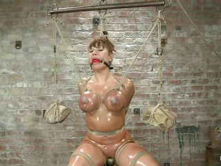 oiled busty milf tortured