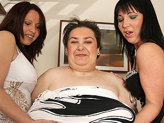 Three old and juvenile lesbos have fun on the couch