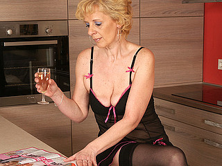 This blond aged slut can't live without to masturbate in her kitchen