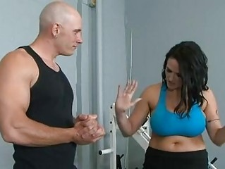 Black haired pornstar with massive puppies receives banged in gym