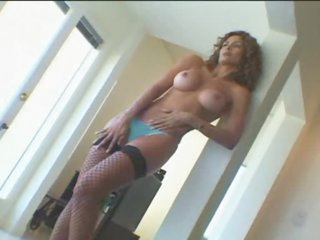 Latin milf with curly hair and big perky tits
